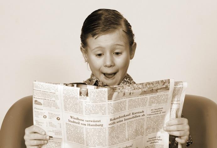 Little boy newpaper