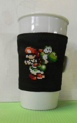 Cross Stitched Yoshi's Island w/Baby Mario Drink Cozy by pandakabobs