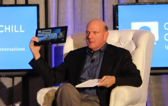 Microsoft CEO Steve Ballmer holds a Surface, running Windows 8, which he says can serve as a digital dashboard