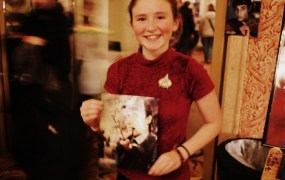 A young Trekkie proudly holding a Spiner-signed Data pic.