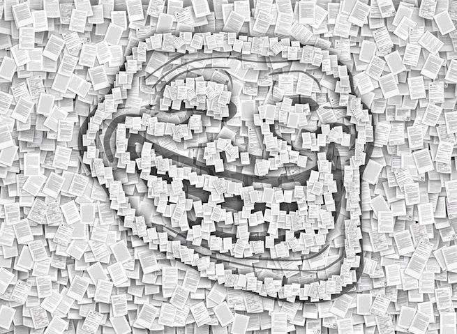 Troll face image via iunewind/Shutterstock