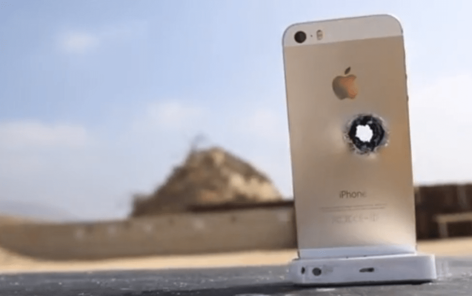 The iPhone 5S bows to the power of a sniper rifle.