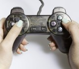 A woman holds a game controller