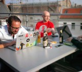 Members of the 6Wunderkinder team work on a Berlin rooftop
