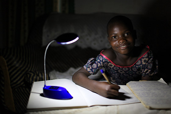 A beneficiary of Solar Sister.
