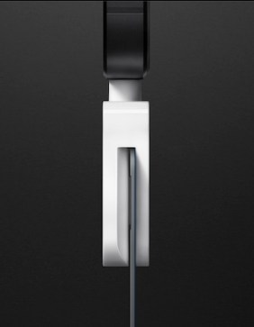 A side view of Square's newest credit card reader dongle.