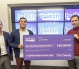Twitch CEO Emmett Shear hands the Red Cross a $90,000 check for Typhoon Haiyan relief aid.