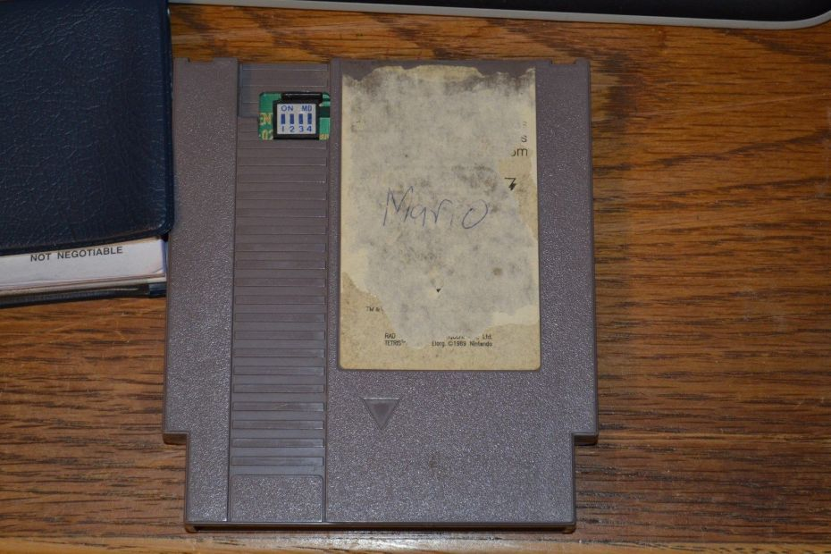 A beat up Nintendo World Championship cartridge.