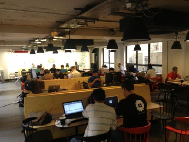 Entrepreneurs working at White Bear Yard, an East London coworking space .