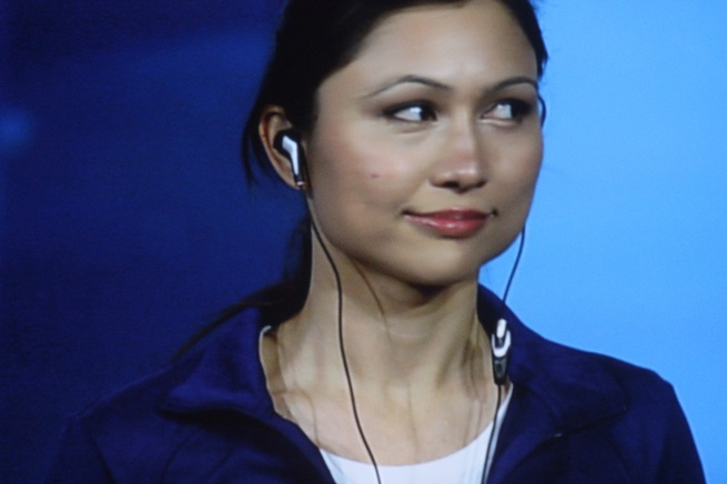 Intel smart earbuds, modeled by their inventor, Indira Negi.