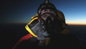 Dean Hall on the summit of Mount Everest.