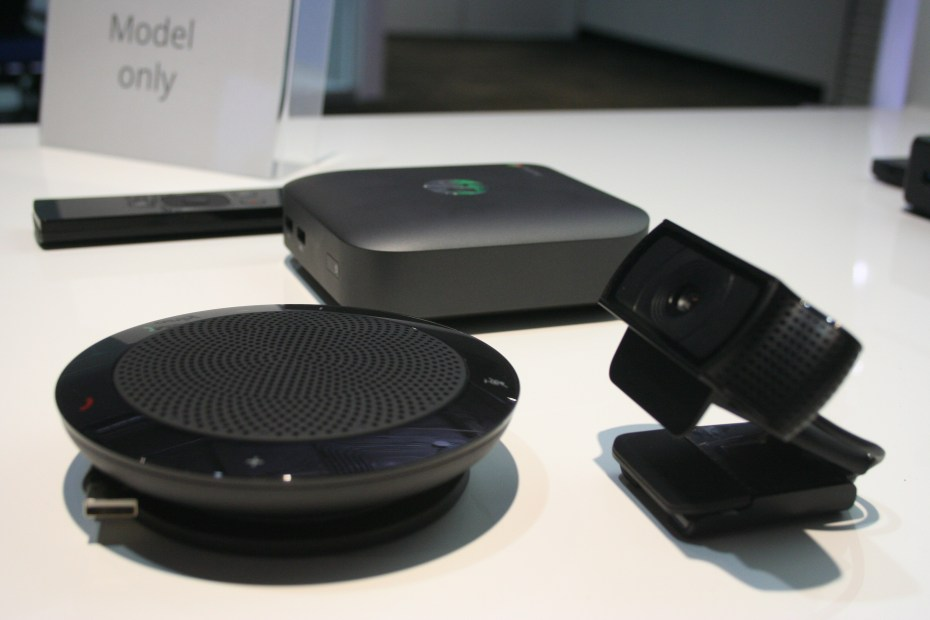 HP's version of the Chromebox for meetings, including a remote control, a speaker, a camera, and the box itself.