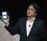 Nintendo president Satoru Iwata holds the company's monkey maker.