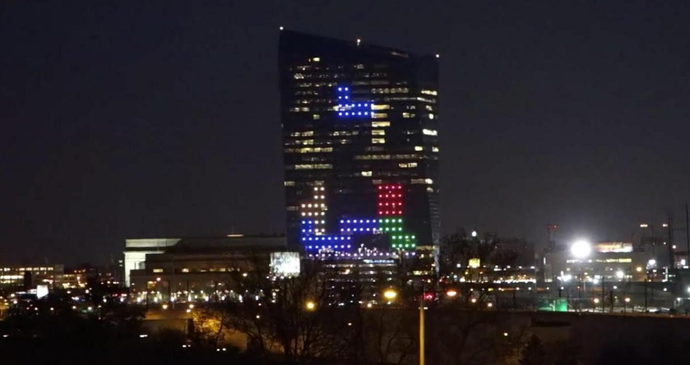 A simulated view of Tetris on the side of a giant building.
