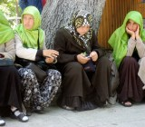 Turkish women using cellphones outside the Blue Mosque in Istanbul, in 2008. Cellphone use is widespread in Turkey.