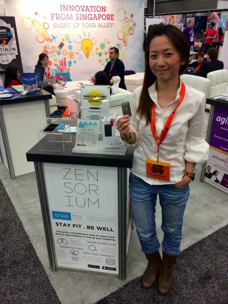 Zensorium's Juliana Chua holds the company's Tinké device at SXSW 2014.