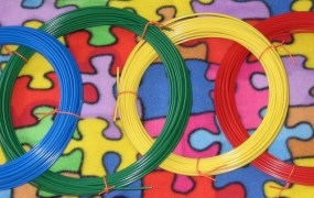 """Multicolored ABS filament rolls are the plastic """"ink"""" used by most consumer 3D printers."""