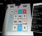 A robot playing Threes.