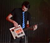Greig Stewart waling on his NES keytar.