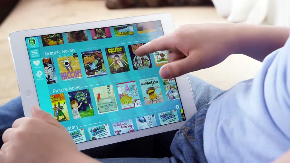 """A kid uses the """"Epic!"""" app for iPad."""