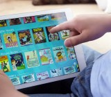 "A kid uses the ""Epic!"" app for iPad."