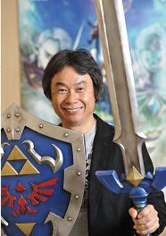 Legend-of-Zelda-Hyrule-Historia-Shigeru-Miyamoto-Holding-Master-Sword