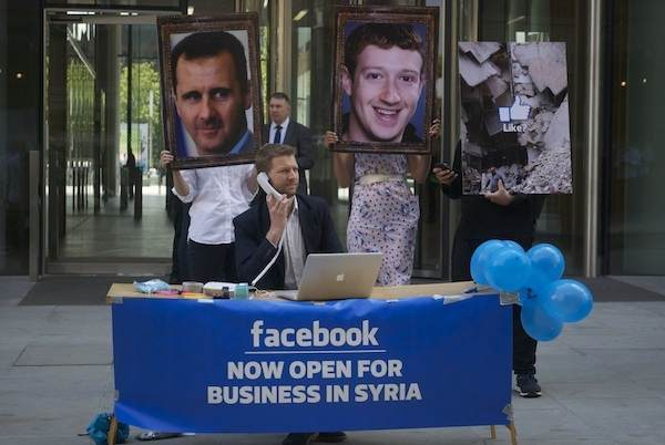 The so-called Syria Campaign activist group protesting outside Facebook's London office.