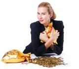 Woman gold coins Elnur Shutterstock