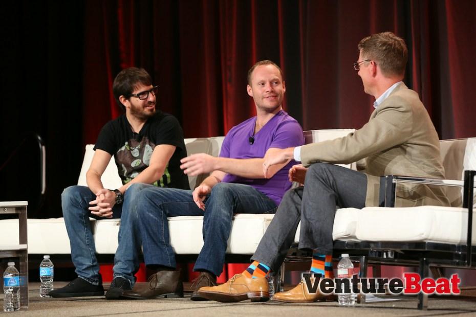 Yo! founders Moshe Hogeg and Or Arbel speak with VentureBeat's Dylan Tweney (L-R).