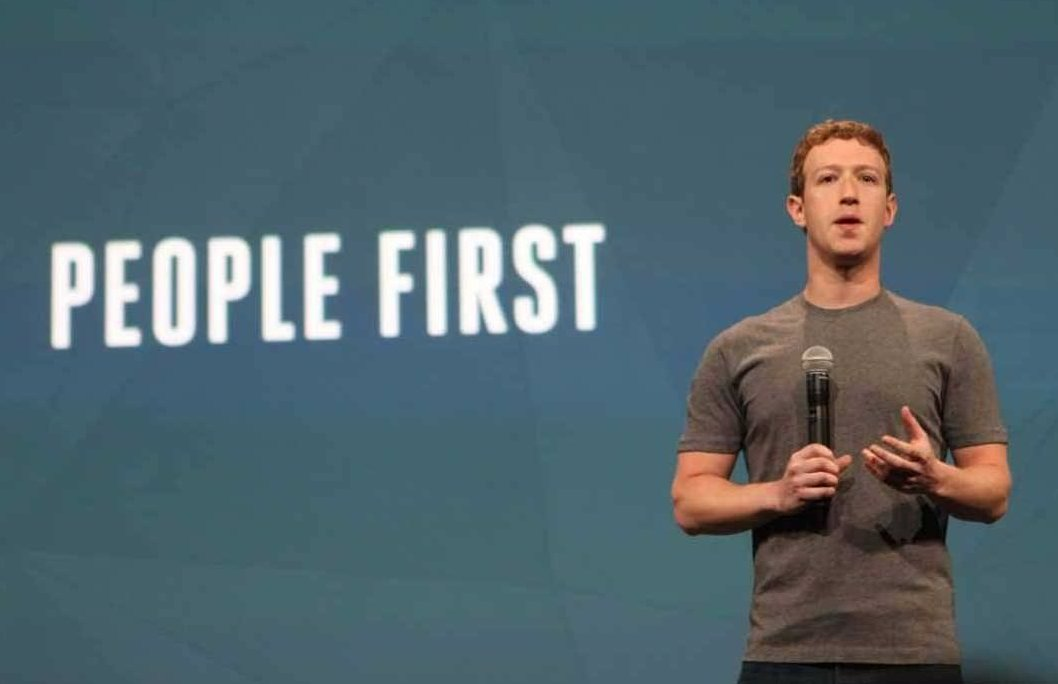 """""""People first,"""" the slide behind Facebook founder Mark Zuckerberg proclaims."""