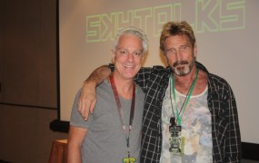 John McAfee, right, and former VentureBeat writer Richard Byrne Reilly at the Def Con 22 conference in Las Vegas in August 2014.