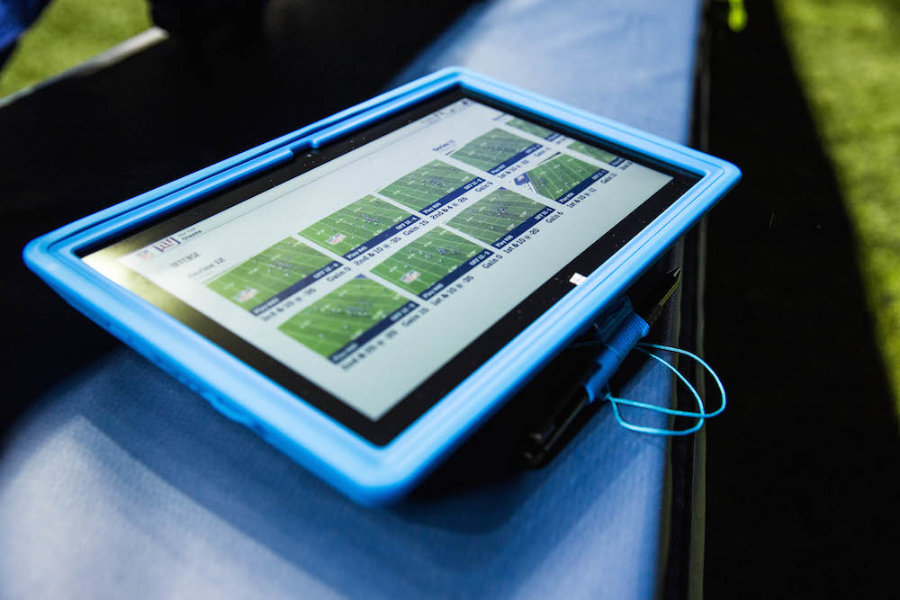 Microsoft's Surface tablets replace paper printouts on NFL sidelines.
