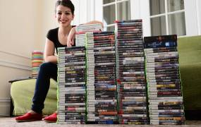 Anita Sarkeesian of Feminist Frequency with the games she purchased as part of her research.