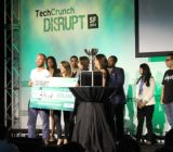 The people of Alfred accept the TechCrunch Startup Battlefield award.