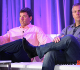 Peter Levin, left, president of interactive ventures and games at Lionsgate, speaks with Chris Petrovic, head of corporate development at Kabam, at VentureBeat's 2014 GamesBeat conference in San Francisco on Sept. 15.