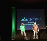 Techstars founding partners Brad Feld, David Cohen, and David Brown on stage at the 2014 Techstars Austin demo day.