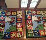A pair of original Mario quilts.