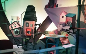 A shot from Lumino City, a puzzle platform game made from paper.