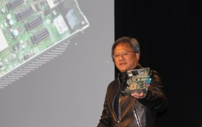 Nvidia CEO Jen-Hsun Huang with Nvidia Drive CX, a digital cockpit computer for cars.