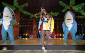 Katy Perry dances with some not-quite-in-sync sharks.