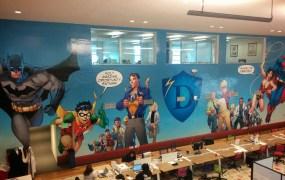A mural at Hero City features Batman, Robin, Superman, Wonder Woman -- and Tim Draper.