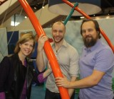 Lynne Vandeveer, Nils Bojin, and Greg Zeschuk at the GDC 2015. They combining Biba's mobile kids activity app and PlayPower's playground equipment.