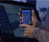 Microsoft's Joe Belfiore gets ready to demonstrate Microsoft's Continuum feature on a phone running Windows 10 at Microsoft's Build conference in San Francisco on April 29.