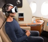 Qantas lets first-class passengers view virtual reality tours with a Samsung Gear VR.