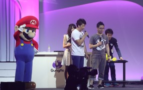 Gung Ho CEO Kazuki Morishita joins Mario on stage at Gung Ho Fest 2015 to announce a partnership with Nintendo to bring its top game to 3DS.