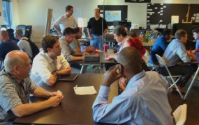 "Founders participate in a ""speed dating"" session at a Startup Weekend event."