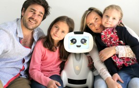 Buddy the robot with family