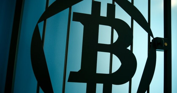 A Bitcoin (virtual currency) logo is pictured on a door at La Maison du Bitcoin in Paris. Reuters / Benoit Tessier