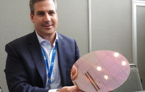 Chris Walker, vice president and general manager of notebook product group at Intel, shows off a wafer with Skylake chips. There are more than 300 chips on the wafer.