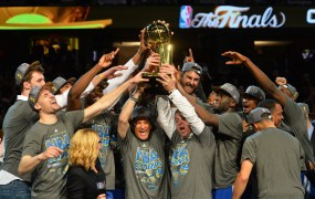 The Golden State Warriors celebrate winning the Larry O'Brein Trophy in Game Six of the 2015 NBA Finals. Copyright 2015 NBAE (Photo by Jesse D. Garrabrant/NBAE via Getty Images)